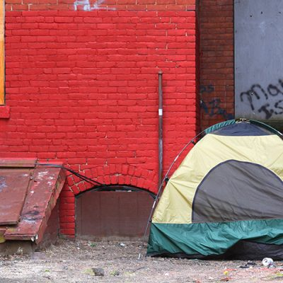 Homeless tent in an alley